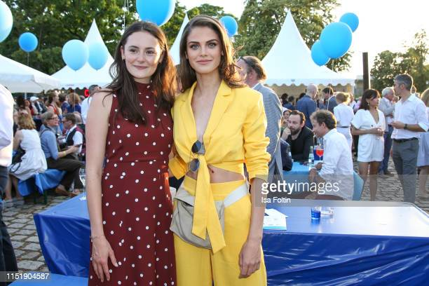 German actress Lea van Acken and model and actress Lisa Tomaschewsky attend the summer party of the German Producers Alliance on June 25, 2019 in...