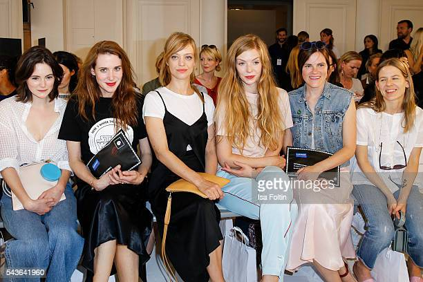 German actress Lea van Acken, Julia Malik, Heike Makatsch, Pheline Roggan, Fritzi Haberlandt and Aino Laberenz attend the Malaikaraiss defilee during...