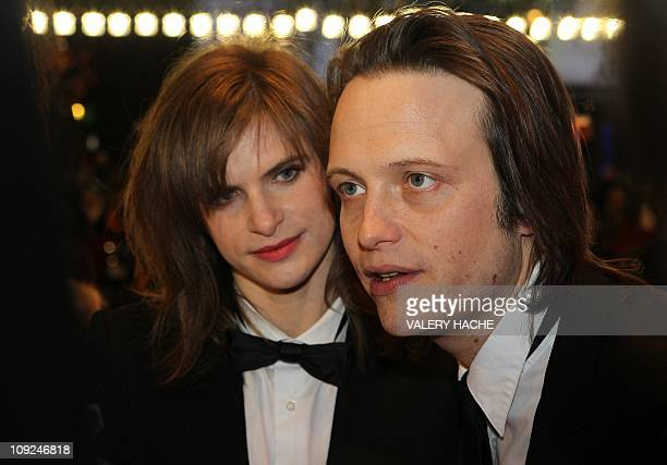 German actress Lena Lauzemis and German actor August Diehl arrive on the red carpet for the premiere of the movie If Not Us Who on February 17 2011...