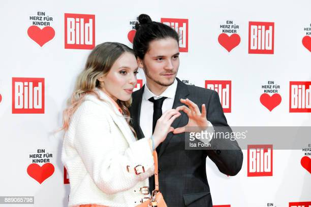 German actress Lina Larissa Strahl and her boyfriend German actor Tilman Poerzgen attend the 'Ein Herz fuer Kinder Gala' at Studio Berlin Adlershof...