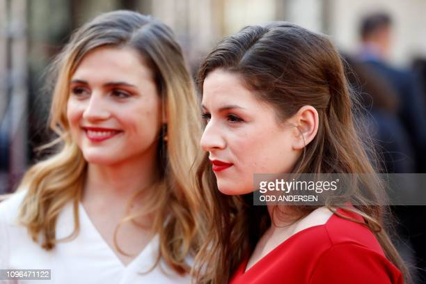 """German actress Lou Strenger and German actress Mala Emde pose on the red carpet ahead of the premiere of the film """"Brecht"""" at the 69th Berlinale film..."""