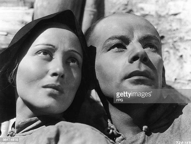 German actress Luise Rainer and American actor Paul Muni play Chinese peasants in the MGM film 'The Good Earth' 1937