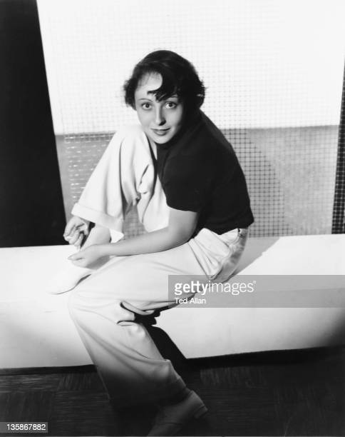 German actress Luise Rainer tying her shoelace circa 1938