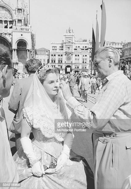 German actress Magda Schneider as Ludovika of Bavaria having her her makeup done on the set of Sissi Fateful Years of an Empress Venice 1957
