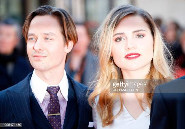 """German actress Mala Emde and German actor Tom Schilling pose on the red carpet ahead of the premiere of the film """"Brecht"""" at the 69th Berlinale film..."""