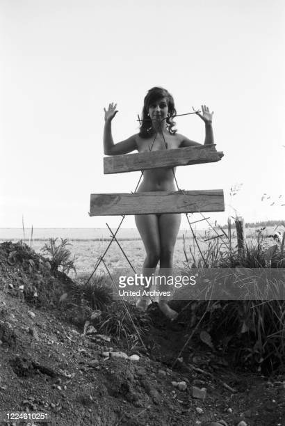 German actress Margot Mahler posing for a photo shoot at the kerbside, Germany, 1960s.
