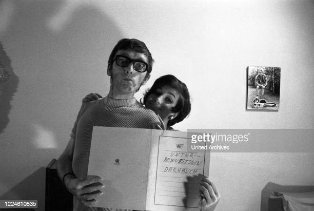 German actress Margot Mahler with photographer and PR manager Heinz Browers, Germany, 1960s.