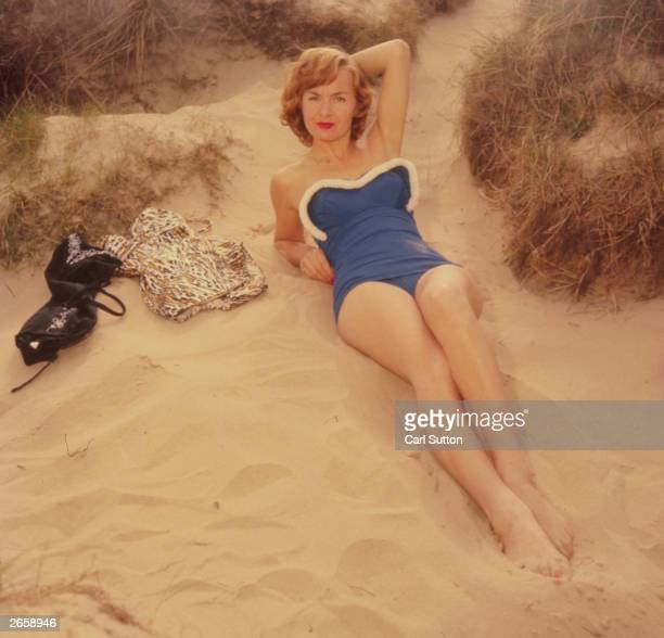 German actress Marianne Brauns on a beach modelling a swimming costume