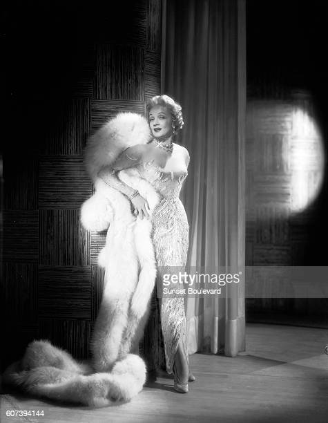 German actress Marlene Dietrich on the set of Stage Fright, directed and produced by British Alfred Hitchcock.