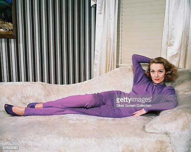 German actress Marlene Dietrich wearing a purple trouser suit circa 1950