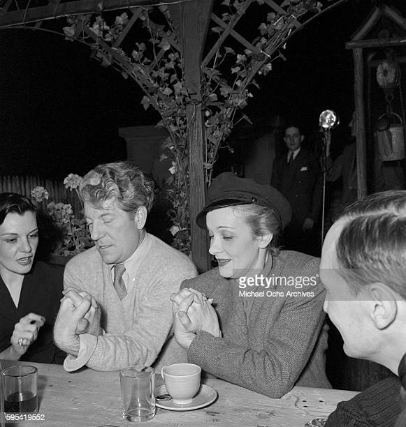 German actress Marlene Dietrich with French actor Jean Gabin and French artist Bernard Lamotte at La Vie Parisienne restaurant located at 3 East 52nd...