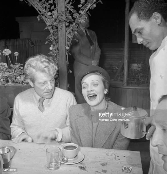 German actress Marlene Dietrich with French actor Jean Gabin at La Vie Parisienne restaurant located at 3 East 52nd Street circa 1942 in New York...