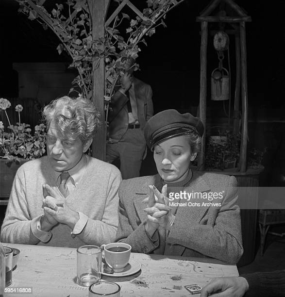 German actress Marlene Dietrich with French actor Jean Gabin play 'Here is the Church, Here is the Steeple' at La Vie Parisienne restaurant located...