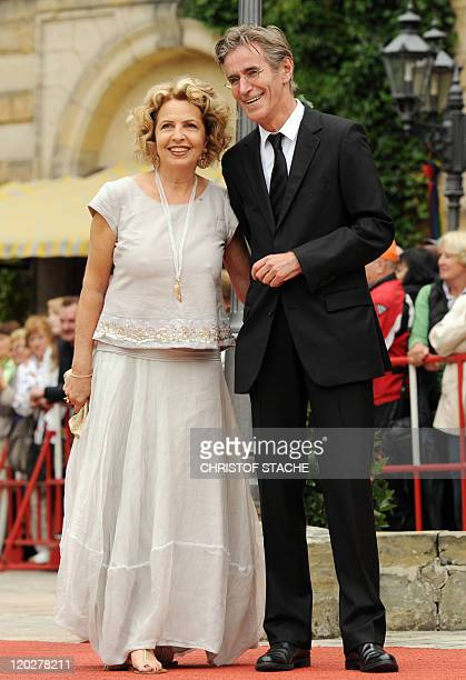German actress Michaela May and her husband Bernd Schadewald arrive on the red carpet at the 'Festspielhaus' ahead of the opening performance of...