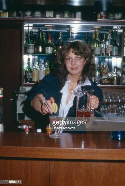 German actress Michaela May at the bar of Sonnenhof hotel, Germany, 1970s.