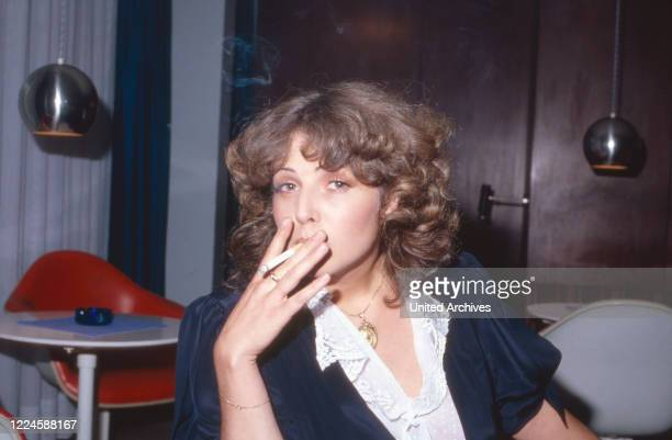 German actress Michaela May having a cigarette, Germany, 1970s.