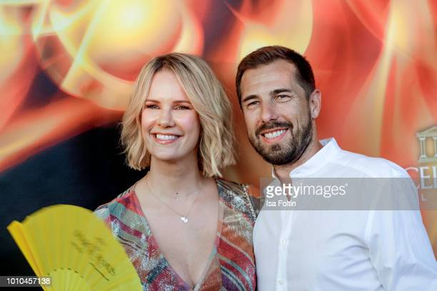 German actress Monica Ivancan and her husband Christian Meier attend the Remus Lifestyle Night on August 2 2018 in Palma de Mallorca Spain
