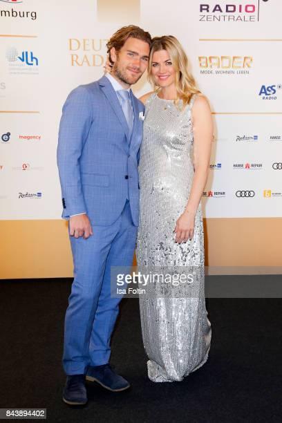 German actress Nina Bott and her boyfriend Benjamin Baarz attend the 'Deutscher Radiopreis' at Elbphilharmonie on September 7 2017 in Hamburg Germany