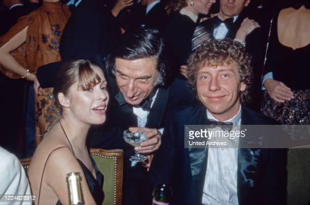 German actress Olivia Pascal with partner Achim Lenz and actor Herbert Fux visiting the Filmball Germany 1980s