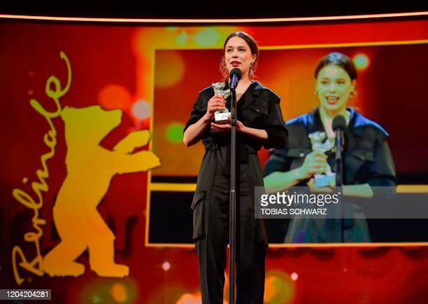 German actress Paula Beer poses with the trophy Silver Bear for Best Actress during the awarding ceremony of the 70th Berlinale film festival in...
