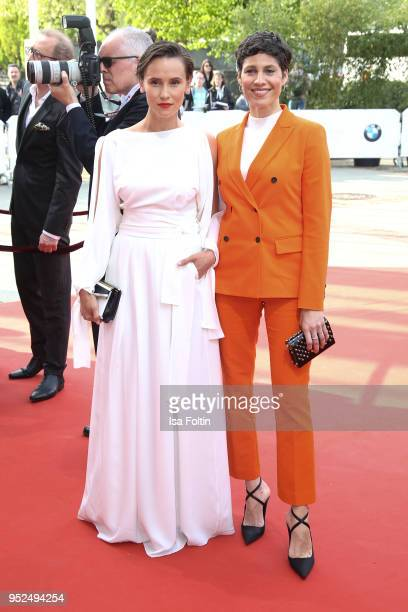 German actress Peri Baumeister and German actress Jasmin Gerat attend the Lola - German Film Award red carpet at Messe Berlin on April 27, 2018 in...