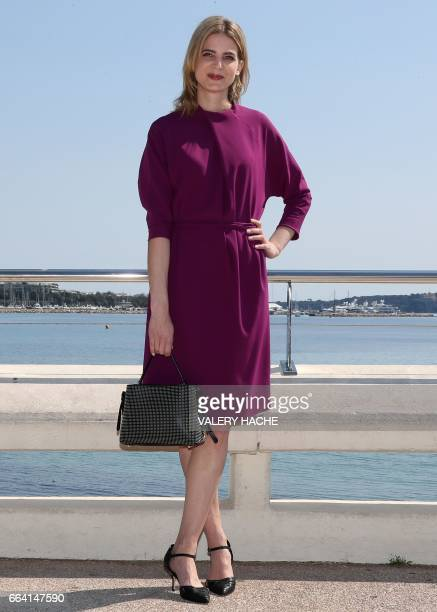 German actress Rike Schmid who stars in the series 'Maltese' poses during a photocall as part of the MIPTV event on April 3 2017 in Cannes...
