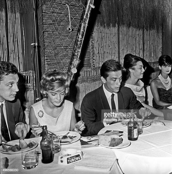 German actress Romi Schneider and French actor Alain Delon partners at the time having the dinner in a club in Torvaianica on the coast of Lazio held...