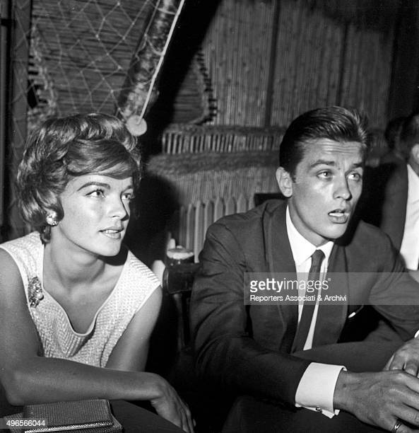 German actress Romi Schneider and French actor Alain Delon partners at the time chatting in a club in Torvaianica on the coast of Lazio during the...