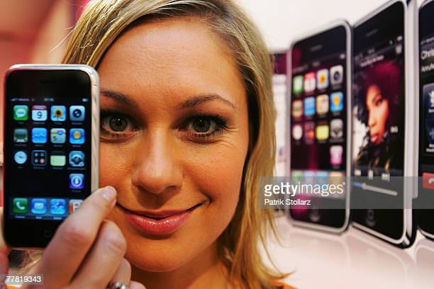 German actress Ruth Moschner presents the iPhone in the TMobile shop November 9 2007 in Cologne Germany The new Apple iPhone was released one minute...