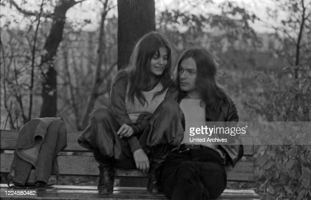 German actress, singer and author Rosemarie Heinikel with a friend at a park, Germany, 1960s.