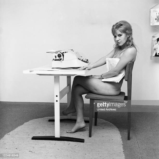 German actress Sissy Engl with a type writer, Germany, 1960s.