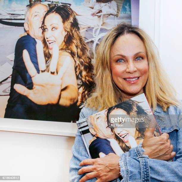 German actress Sonja Kirchberger inf ront of the picture with her of Oliver Rath during the 'FotoKunstBoulevard' exhhibition opening at...