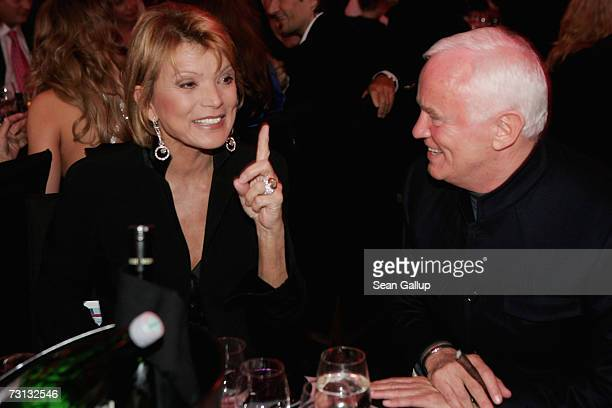 German actress Uschi Glas and fashion designer Werner Baldessarini attend the Kitz Race Party after the Hahnenkamm slalom races January 27, 2007 in...