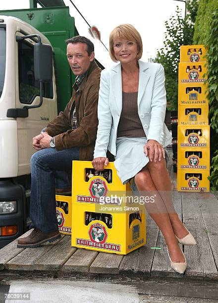German actress Uschi Glas and her colleague Michael Roll pose during the photo call for the TVfilm Zur Sache Lena on August 9 in Aying near Munich...