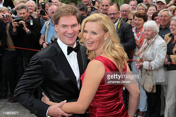 German actress Veronica Ferres and her partner Carsten Maschmeyer pose during the first pause of the Bayreuth festival 2011 premiere on July 25, 2011...