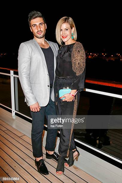German actress Wolke Hegenbarth and her boyfriend Oliver Vaid attend the Fashion2Night event at EUROPA 2 on August 23, 2016 in Hamburg, Germany.