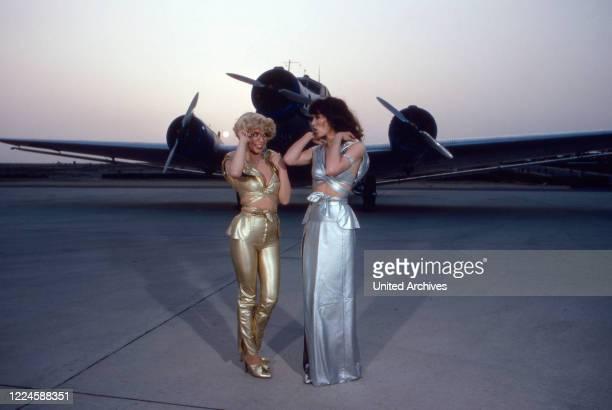 """German actresses Ingrid Steeger and Iris Berben in TV comedy show """"Zwei himmlische Toechter"""", Germany, 1970s."""