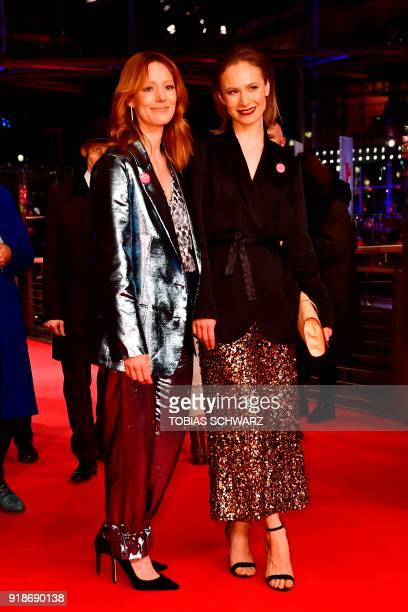 German actresses Lavinia Wilson and Sina Tkotsch pose on the red carpet upon their arrival at the Berlinale Palace for the opening ceremony of the...