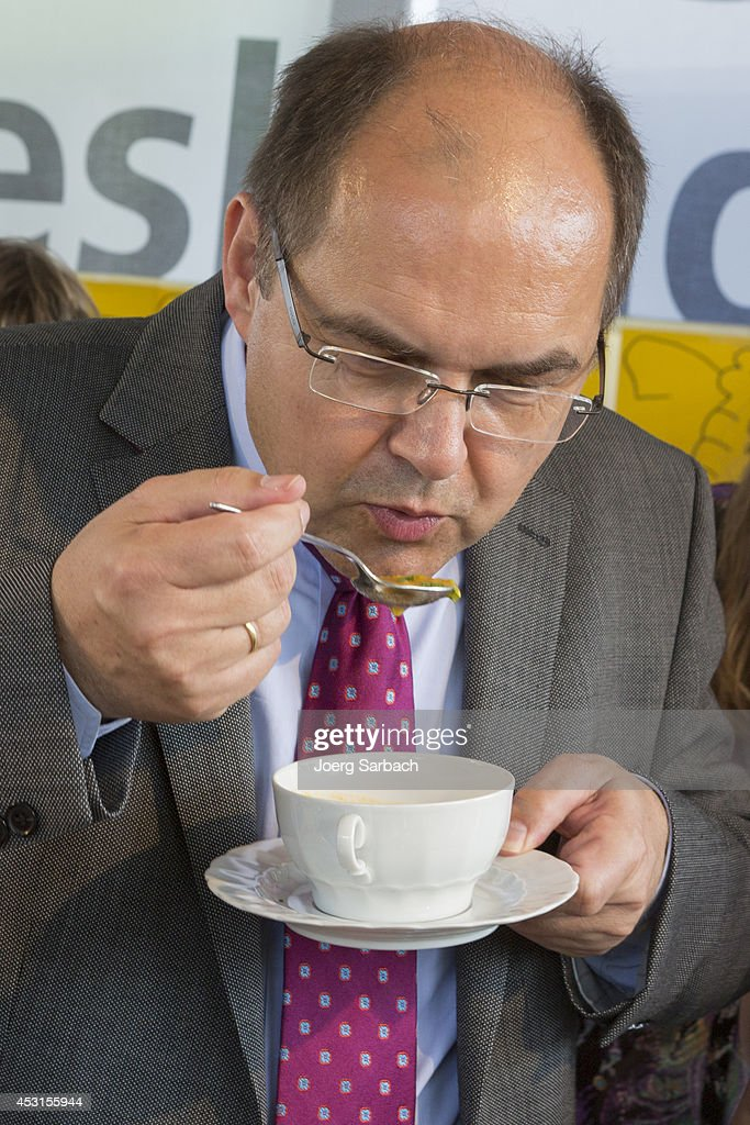 German Agriculture and Consumer Protection Minister Christian Schmidt eats soupt during a visit to a regional garden fair (Landesgartenschau) on August 01, 2014 in Papenburg, Germany.