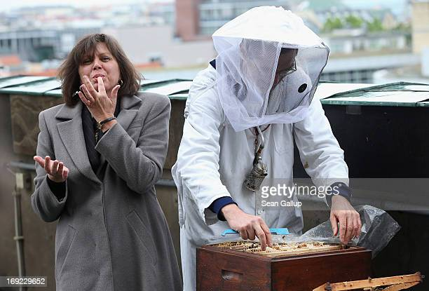 German Agriculture and Consumer Protection Minister Ilse Aigner licks honey from her fingers after holding a bees' honeycomb presented to her by...