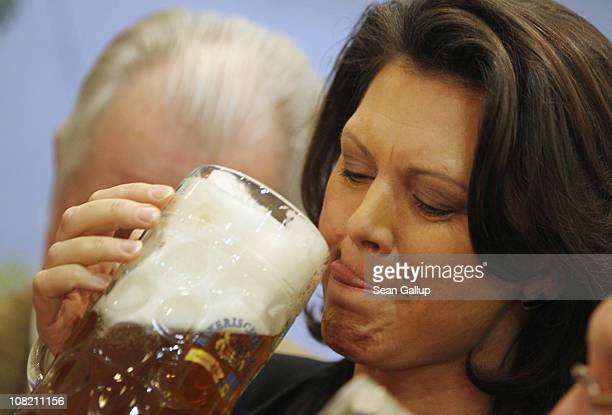 German Agriculture and Consumer Protection Minister Ilse Aigner sips Bavarian beer while touring the 2011 Gruene Woche agricultural trade fair at...