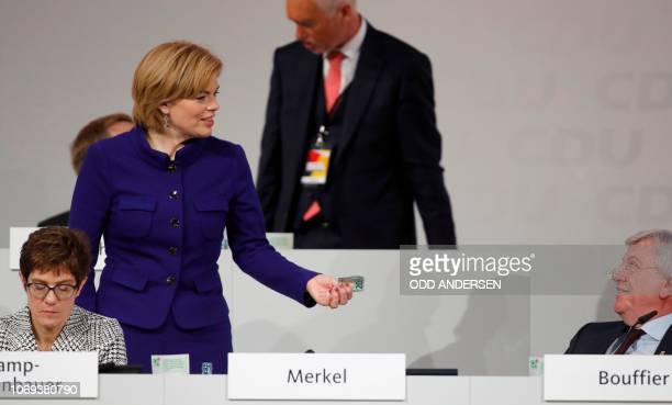 TOPSHOT German Agriculture Minister and Deputy Chairman of the Christian Democratic Union Julia Kloeckner holds a 20euros banknote as CDU Secretary...