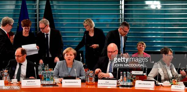 German Agriculture Minister Christian Schmidt German Chancellor Angela Merkel German Chief of Staff and interim Finance Minister Peter Altmaier and...
