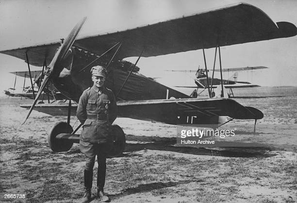 German air ace Ernst Udet standing in front of a Fokker DVll, one of Germany's best fighters.