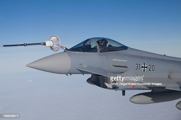 German Air Force Eurofighter Typhoon refueling from an Airbus A310 Multi-role Tanker Transport aircraft.