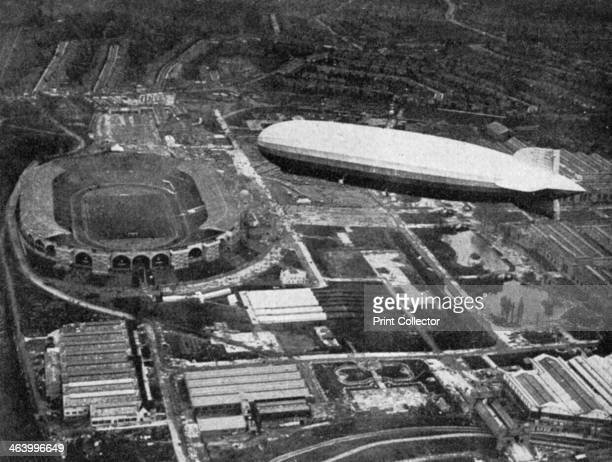 German airship 'Graf Zeppelin' flying over Wembley during the FA Cup Final London 1930 The final was played between Arsenal and Huddersfield Town...