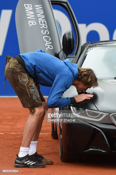 German Alexander Zverev kisses the winner car during the winner ceremony after he won his final match against Argentinian Guido Pella at the ATP...