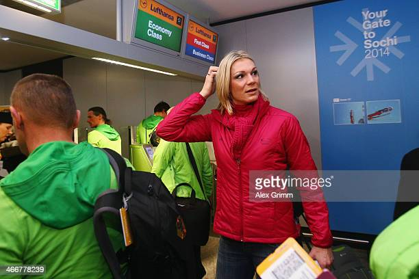 German alpine ski racer Maria HoeflRiesch looks back as Team Germany departs to the Sochi 2014 Winter Olympics from Frankfurt international airport...