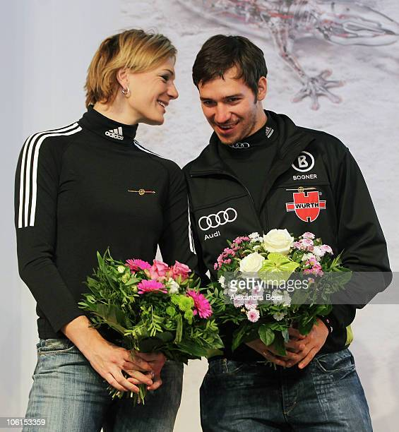 German alpine skiers Maria Riesch and Felix Neureuther chat after they received the 'Golden Ski ' award given from the German Ski Federation to their...