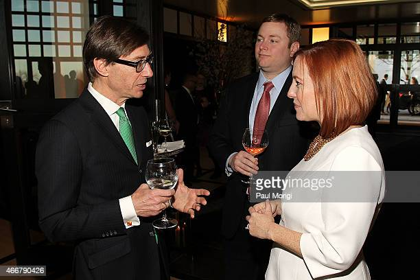 German Amb. Peter Wittig talks with Greg Mecher and Jen Psaki at the ELLE and HUGO BOSS Women in Washington Power List Dinner at The Residence of the...